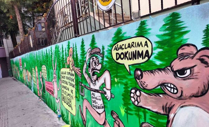 Bahçe duvarlarına çizilen karikatür ile ormanların önemi anlatıldı