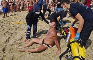 Boğulmak üzere olan turist cankurtaranın ipiyle...